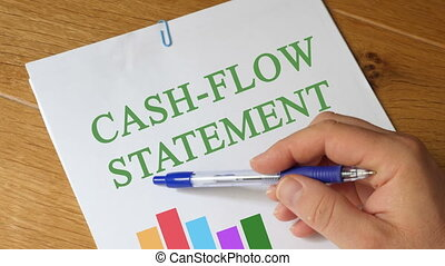 Cash-Flow Statement  Report on Wooden Table
