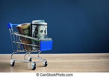 Cash for loan in the shopping cart. Lending money.