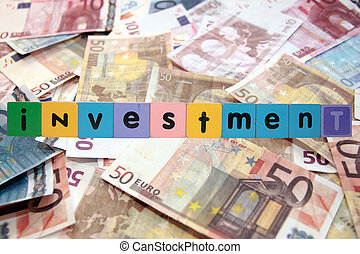 cash house investment in toy letters