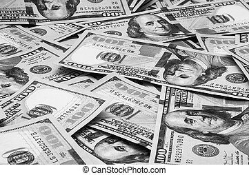 Cash hundred dollar bills, dollar background image. Scattered dollars. A big pile of dollars. Background of North American dollar bills. Black and white style.