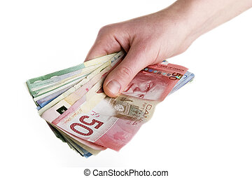 Cash in Hand - A hand full of Canadian Cash