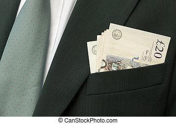 Businessman with cash - UK sterling - in suit pocket.