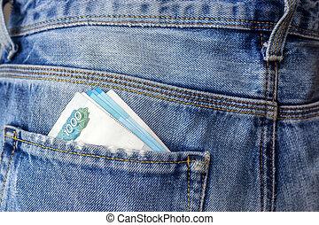 Cash money in back pocket of jeans