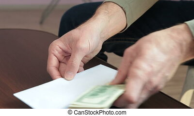 Cash Money In Envelope - Male hands pulling and counting...