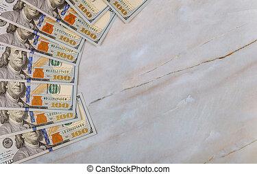 Cash of hundred dollar bills. Close up.