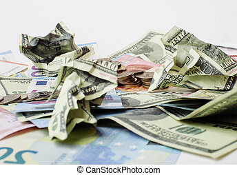 Cash on table isolated: dollars, euro, rubl broken money....
