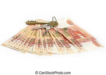 Cash on white background. The keys to the apartment on the money. Bills 5 thousand rubles, spread out like a fan.
