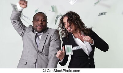 Business partners having fun dancing among flying cash