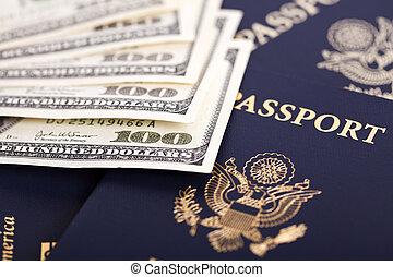 Cash & Passports - A large amount of 100 US dollar money ...