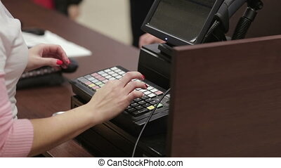 Cash register in the clothing store. payment card. Employees...