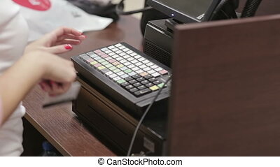 Cash register in the clothing store. payment cash and card....