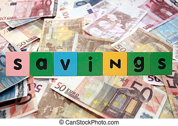 cash savings in toy letters