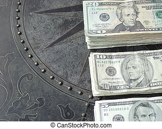 cash spread out on a patterned bronze table top