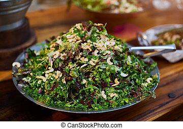 Cashew baby greens salad