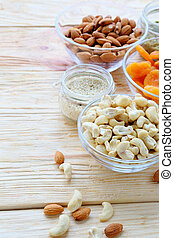 cashew nuts, almonds and dried apricots in a bowl