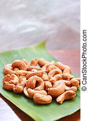 Cashew nuts on banana leaf