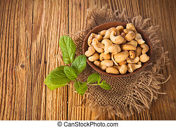 Cashew nuts on wooden table