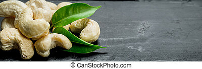 Cashew nuts with leaves .