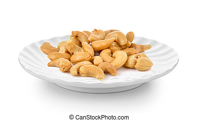 Cashews in plate on white background