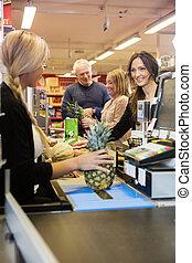 Cashier Making Bills At Checkout Counter