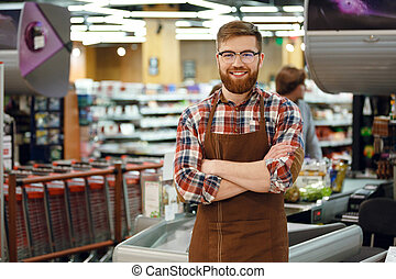 Cashier man on workspace in supermarket shop - Picture of...