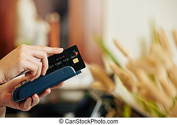Cashier swiping credit card