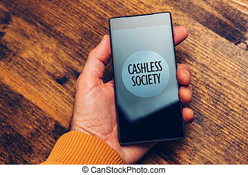 Cashless society concept, man using smartphone for electronic payment