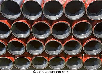 Casing pipe ready to be run in the hole on a drilling platform