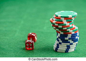 casino chips and red dice