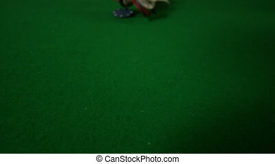 Casino chips falling towards camera in slow motion
