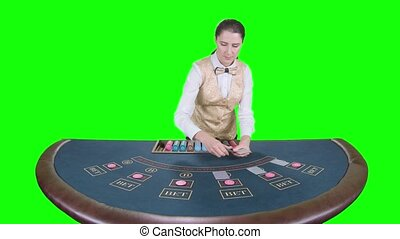 Casino croupier distributes for table poker three cards are...