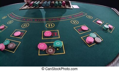 Casino croupier distributes the cards in the form of a arc...