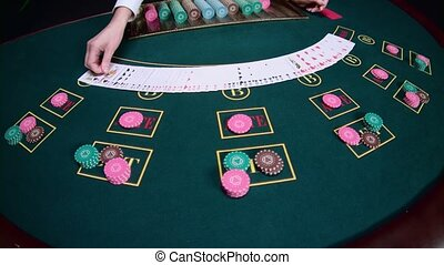 Casino croupier shuffles the cards. Slow motion. Close up -...