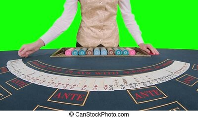 Casino croupier smoothes the poker cards. Green screen. Slow...