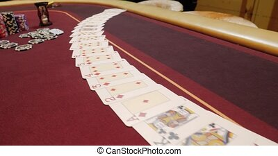 Casino: Dealer man shuffles the poker cards and performing trick with cards