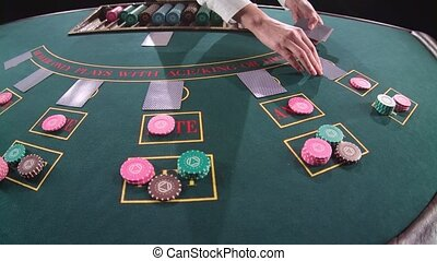 Casino dealer shuffles the cards. Slow motion. Close up