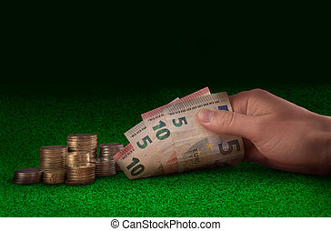 Casino, gambling exchanging money at green casino table....