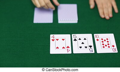 holdem dealer with playing cards - casino, gambling, poker,...