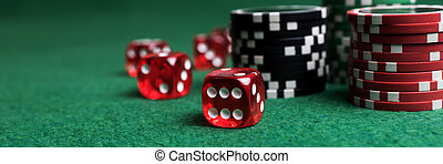 Poker chips and red dice on green table
