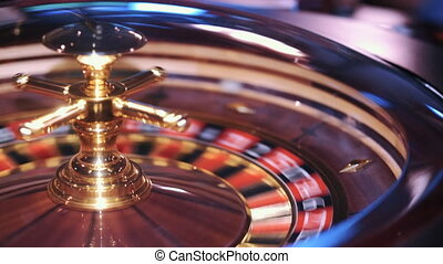 casino: man playing electronic roulette