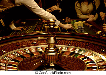 This photograph represent gold image of roulette, tabel and players (blurred motion)