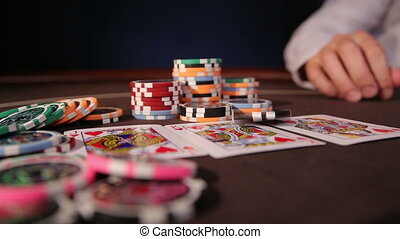 Casino. Playing with chip. Poker table