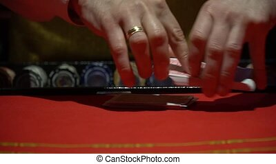 Casino, poker: Dealer shuffles the poker cards