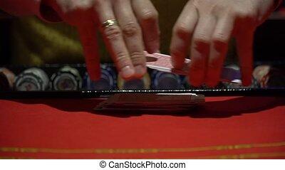 Casino, poker: Dealer shuffles the poker cards
