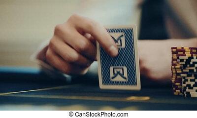 casino: poker, man throws cards. slow motion