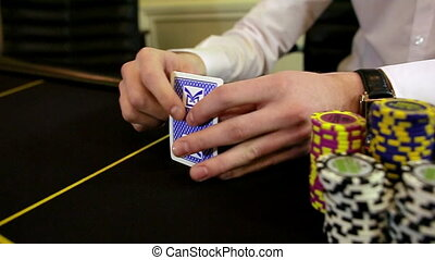 casino: poker, man throws cards. slow motion