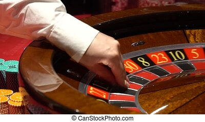 Casino roulette in motion, the spinning wheel ball and...