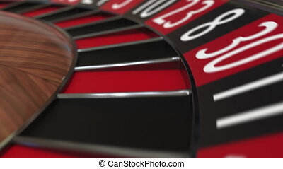 Casino roulette wheel ball hits 1 one red