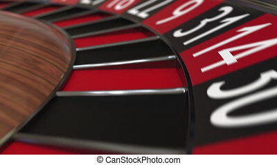 Casino roulette wheel ball hits 12 twelve red