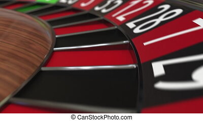 Casino roulette wheel ball hits 15 fifteen black, close-up...